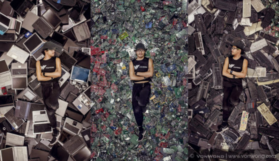 Photographer Benjamin Von Wong lies among the pile of e-waste.